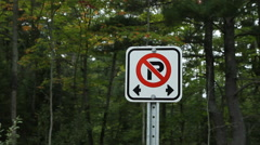 No parking sign. Forest background. Wide shot. Stock Footage