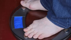 Time lapse with  weighing on scales - weight gain Stock Footage