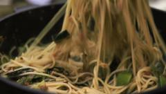 Fresh Spaghetti with tomato sauce in frying pan Stock Footage