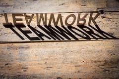 Wooden letters build the word teamwork Stock Photos