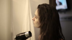 Woman dries hair in the bathroom. Chekout from a hotel room. Stock Footage