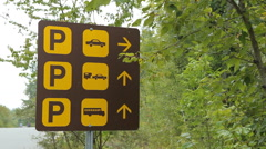 Multiple vehicle parking sign. French River Provincial Park, Ontario, Canada. - stock footage