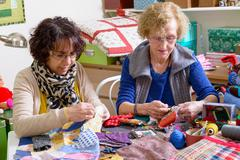 Two women working on their quilting Stock Photos
