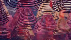 Incense coils and prayer cards, Tin Hau Temple, Hong Kong - panning shot Stock Footage