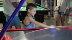 Child playing air hockey, joy and emotion, 1080p HD video Stock Footage