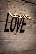 Wooden letters build the word Love Stock Photos