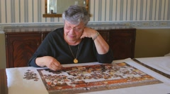 Mature woman and Jigsaw Puzzle - stock footage