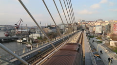 TrainIstanbul subway metro train passing from the Golden Horn Metro Bridge Stock Footage