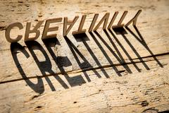 Wooden letters build the word creativity Stock Photos