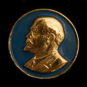 Soviet badge Lenin golden relief on a blue background - stock photo