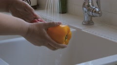 Mature Woman Washing Vegtables Stock Footage