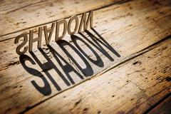 Wooden letters build the word shadow - stock photo