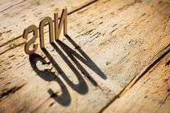 Wooden letters build the word sun - stock photo