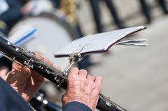 Man plays the clarinet during a religious cerimony Stock Photos