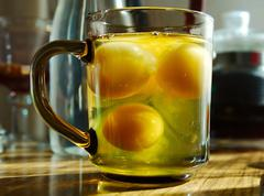 The egg yolks in a glass mug on the kitchen table Stock Photos