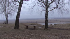 Bench between 2 trees on the high Bank of the Oka river Stock Footage