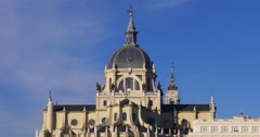 blue sky madrid sunny day almudena cathedral front top 4k spain - stock footage