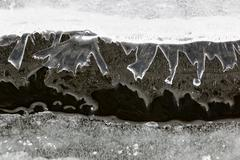 Thin and sharp layers of ice reflecting from water surface Stock Photos