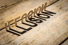 Wooden letters build the word illusion Stock Photos