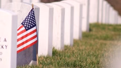 American Flag at soldiers grave Stock Footage