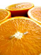 Orange cut by fractions Stock Photos