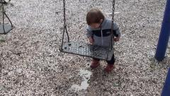 Toddler puts stones into his pocket Stock Footage