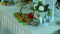 Table setting with the baked sterlet by waiters in a banquet hall. Stock Footage