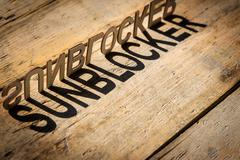 Wooden letters build the word sunblocker Stock Photos