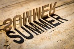 Wooden letters build the word summer - stock photo