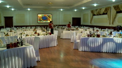 Table setting by waiters in a banquet hall. Stock Footage