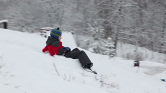 The child slides from an ice slope Stock Footage