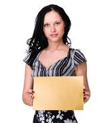 Stock Photo of Smiling young business woman showing blank signboard over white