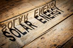 Wooden letters build the word solar energy Stock Photos