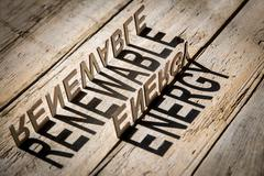Wooden letters build the word renewable energy - stock photo