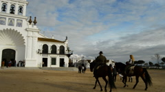 Riders on church of Rocio Virgin in Huelva a spring afternoon Stock Footage
