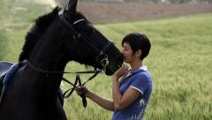 Girl kissing A Horse slow motion Stock Footage