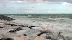 Storm rocks sea waves breakers clouds foam horizon - stock footage