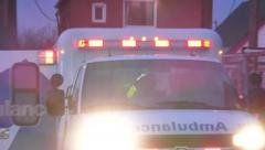 Paramedic silhouette doing chest compressions in the back of ambulance Stock Footage