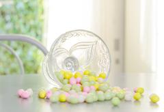 Cup filled with candy for Easter reversed Stock Photos