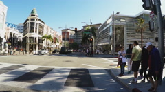 Pedestrians Crossing Rodeo Drive Intersection- Beverly Hills CA Stock Footage