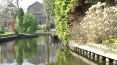 Small boats sailing in Giethoorn Stock Footage