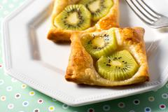 Kiwi Tart on flaky pastry crust Stock Photos