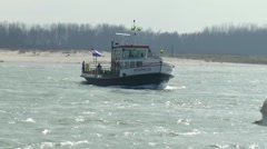 Small ferry crossing river Ijssel from Tiel to Wamel Stock Footage