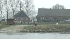 Small ferry crossing river Ijssel from Brummen to Bronkhorst Stock Footage