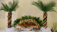Fruit table in the form of palm - stock footage