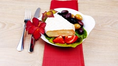 Stock Video Footage of aged camembert cheese on green salad