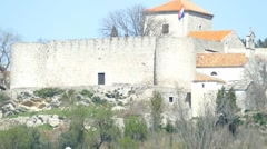 Old Ancient Fortress With Croatian Flag On The Wind Stock Footage