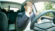 Stock Video Footage of Happy handsome business man driving car singing happy