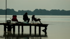 People fishing on a dock in the early morning. Stock Footage