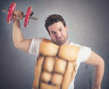 Fat man with abs Stock Photos